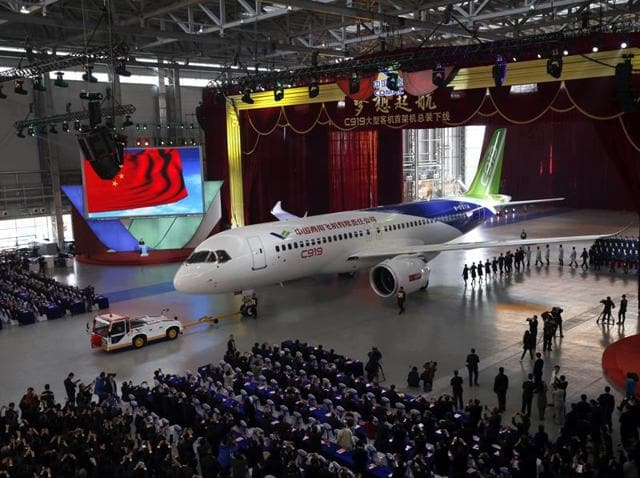 China's first big passenger plane C919, a narrow-body jet which can seat 168 passengers goes on display at a facility in commercial hub in Shanghai .