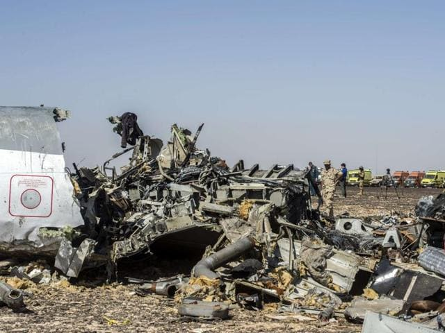 Debris belonging to the A321 Russian airliner are seen at the site of the crash in Wadi el-Zolmat, a mountainous area in Egypt's Sinai Peninsula.
