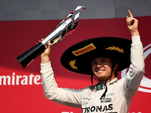 Nico Rosberg of Mercedes GP lifts the trophy as he celebrates on the podium after winning the Formula One Grand Prix of Mexico at Autodromo Hermanos Rodriguez.