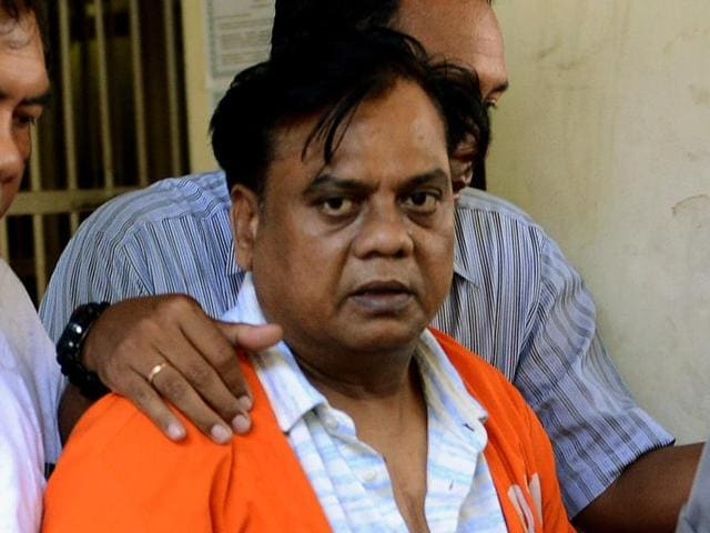 Chhota Rajan, is brought out from a holding cell at the Bali police headquarters in Denpasar on Bali island.