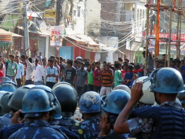 Nepalese police face off with protesters during clashes near the India-Nepal border at Birgunj