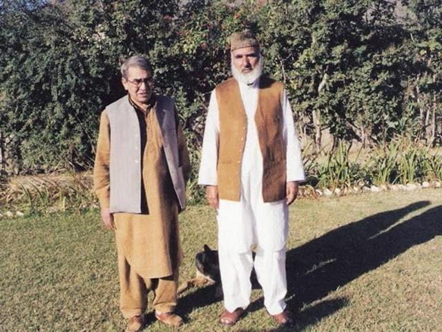 An undated photograph shows prominent Pakistani Pashtun leader Afzal Khan Lala (R) posing for a photograph with a friend in Swat Valley.