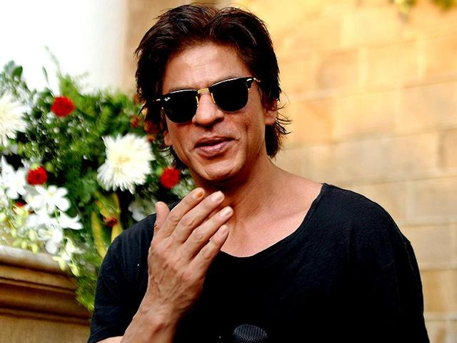 Shah Rukh Khan poses for a photograph during a photocall for his 49th birthday celebrations at his home in Mumbai on November 2, 2014.