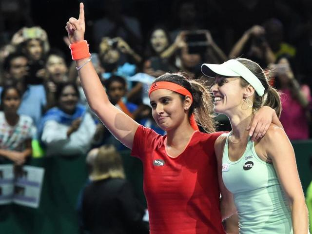 Martina Hingis and Sania Mirza celebrate after winning the WTA Finals in Singapore on November 1, 2015.