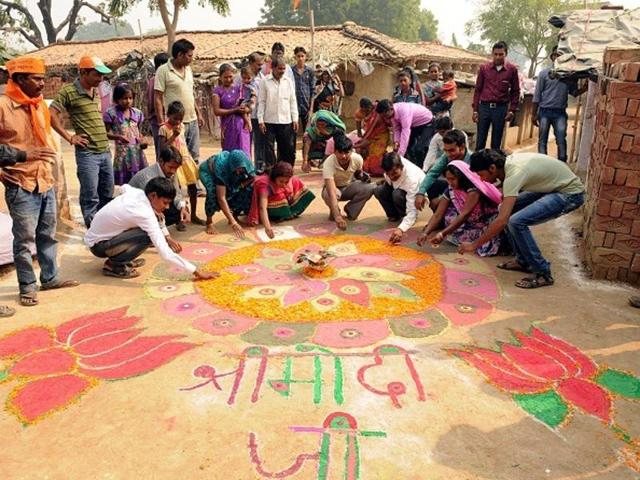 In this file photo, villagers make a rangoli to welcome Prime Minister Narendra Modi to Jayapur.