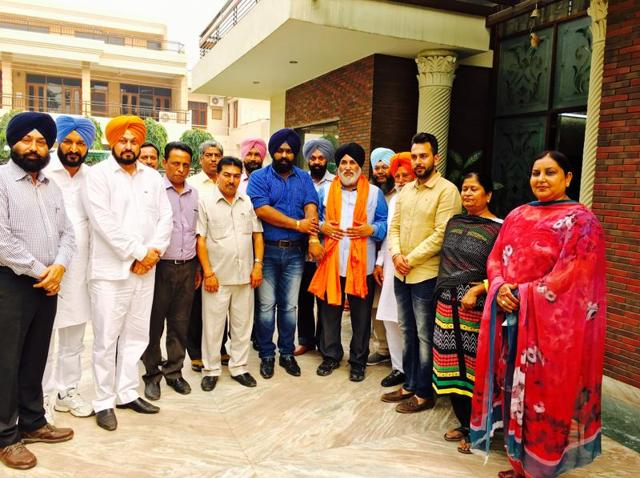 Punjab education minister Daljeet Singh Cheema (fourth from right) at the residence of a Shiromani Akali Dal worker in SAS Nagar on Monday.