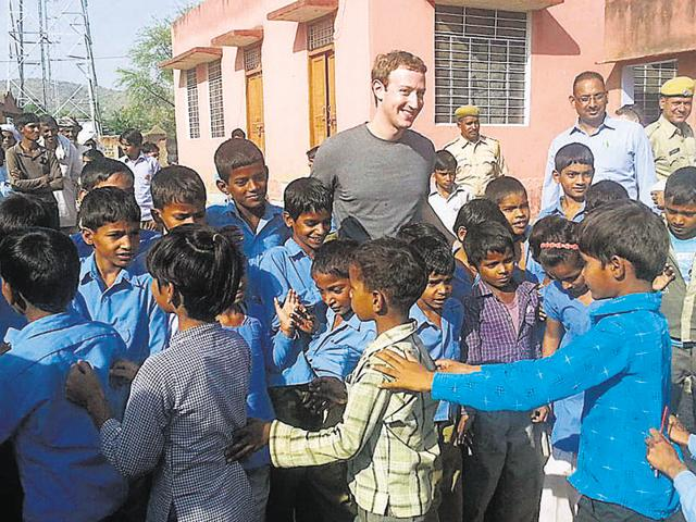 Facebook founder Mark Zuckerberg with children at a government school in Alwar.(HT file photo)