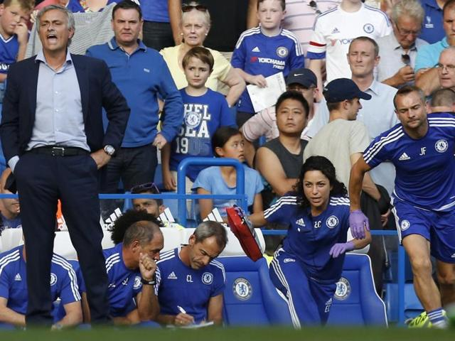 An August 8, 2015 file photo of former Chelsea doctor Eva Carneiro, second from right, and head physio Jon Fearn, right, running out to treat midfielder Eden Hazard during the EPL season opener against Swansea.