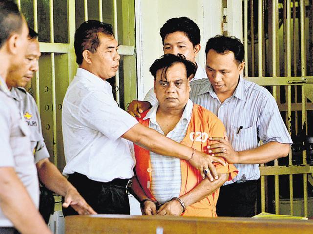 Rajendra Sadashiv Nikhalje alias Chhota Rajan (in orange jacket) was arrested in Bali, Indonesia. He will be extradited to India.