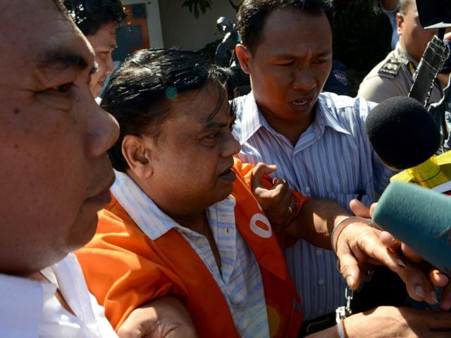 Rajendra Sadashiv Nikalje, 55, known in India as Chhota Rajan, is brought out from a holding cell at the Bali police headquarters in Denpasar on Bali island.