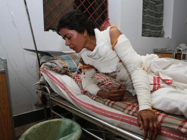 File photo of Pakistani burn victim Sonia Bibi, 20, resting on a hospital bed at a hospital in Multan. She was burned over nearly half her body after she refused to marry her former lover.