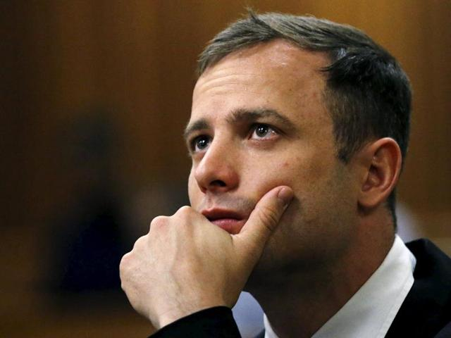 Olympic and Paralympic track star Oscar Pistorius looks on ahead of his sentencing hearing at the North Gauteng High Court in Pretoria, in this October 16, 2014 file photo.