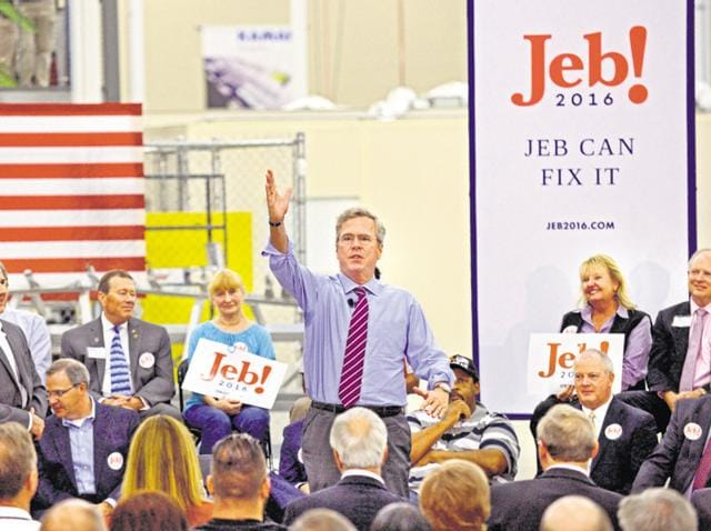 "Jeb Bush (centre) campaigns for his presidency as a part of his ""Jeb Can Fix It"" tour in Jacksonville, Florida, on Monday."