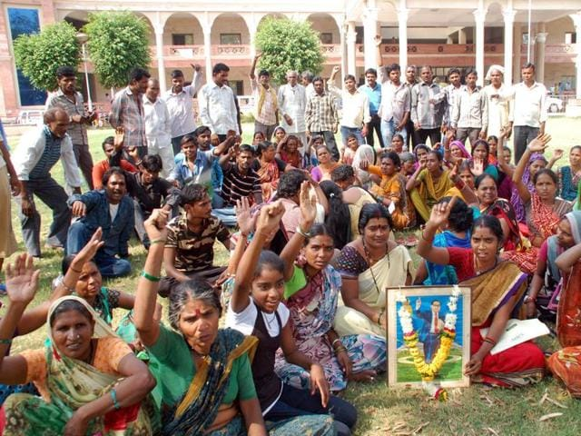 Residents of Ramabai Nagar stage a protest at district collectorate office in Indore on Tuesday.