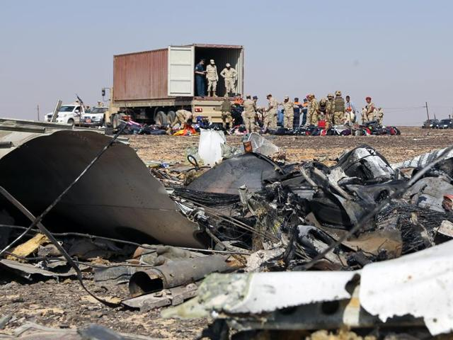 A handout picture taken on November 2, 2015 and released on November 3, 2015 by Russia's Emergency Ministry shows Russian emergency services personnel and Egyptian servicemen working at the crash site of a A321 Russian airliner in Wadi al-Zolomat, a mountainous area of Egypt's Sinai Peninsula.