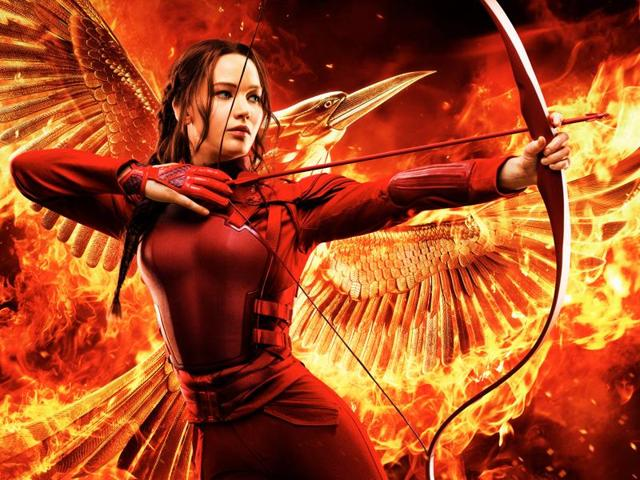 The end is nigh as Katniss aims her bow.