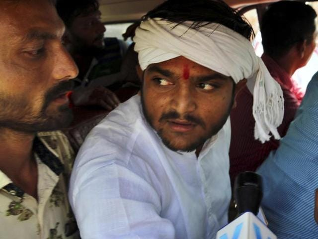 Patidar Anamat Andolan Samiti Conveyor Hardik Patel being produced in Fast Track Court in Surat. Patel faces charges of sedition, over his alleged remarks encouraging his supporters to kill policemen.