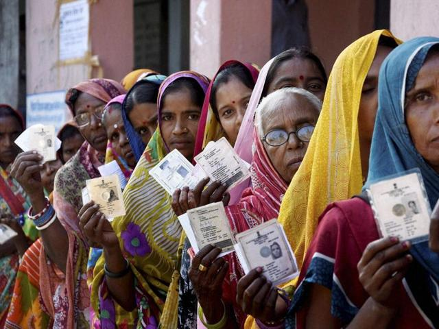 Women voters wait in a queue to cast their votes during fourth phase of Bihar elections in Muzaffarpur.