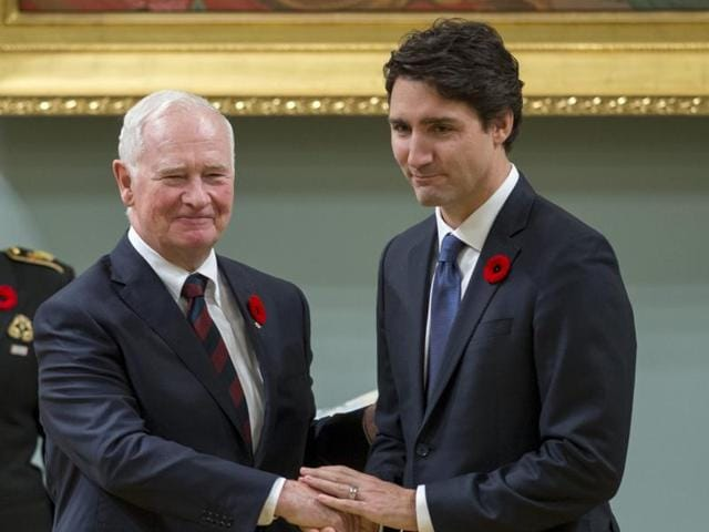 Canadian Prime Minister Justin Trudeau (right) shakes hands with Governor General David Johnston after being sworn in as Prime Minister in Ottawa.