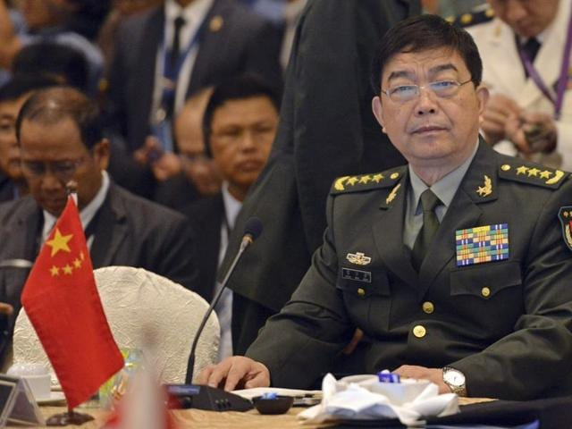China's defense minister Chang Wanquan (R) sits before the start of the Association of Southeast Asian Nations (Asean) defense ministers' meeting, in Kuala Lumpur, Malaysia.