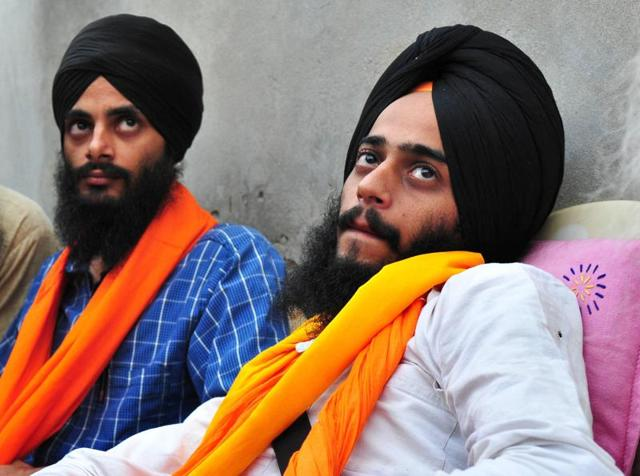 Brothers Rupinder Singh (right) and Jaswinder Singh during apress conference at Panjgrain Khurd village in Moga district on Tuesday after their release from jail.