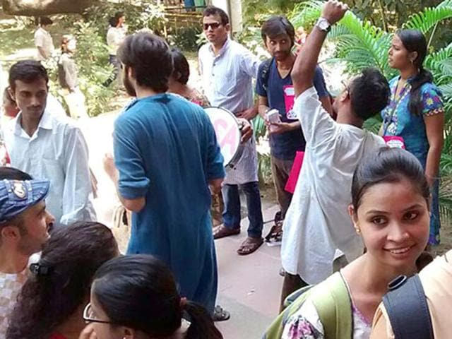 Jawaharlal Nehru University students wait to cast their vote in the students' body polls inside the JNU campus in New Delhi .