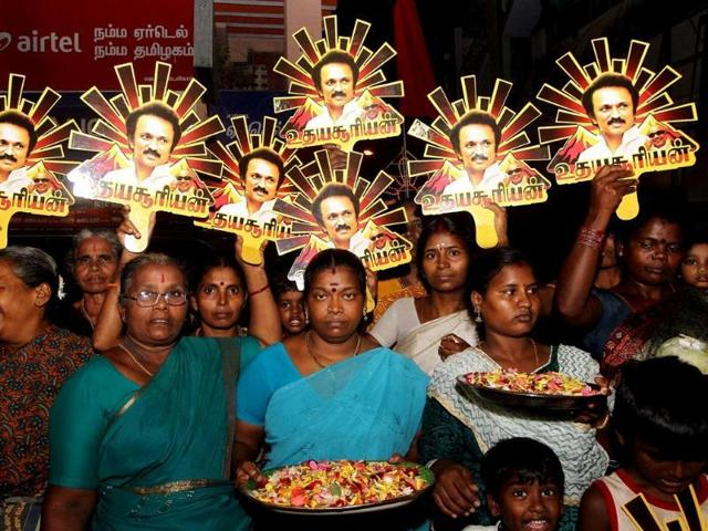 Supporters hold up cut-outs of the DMK party symbol with images of MK Stalin during DMK Chief M Karunanidhi's son and DMK leader MK Stalin's election campaign rally in Chennai on Sunday. (PTI Photo)