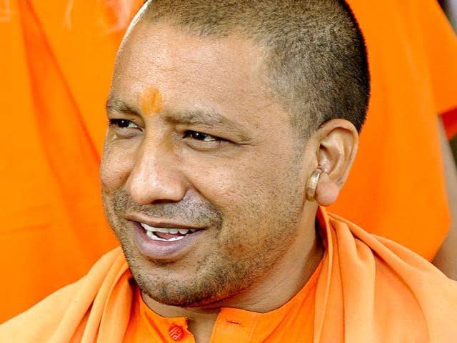 Controversial BJP lawmaker Yogi Adityanath has asked people opposing yoga and 'surya namaskar' to leave India or drown themselves in the ocean.(HT Photo)