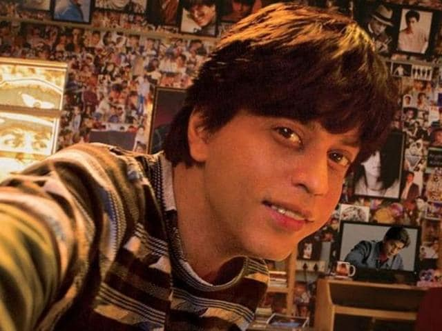 His wall is filled with posters and pictures of Shah Rukh (who will be called Aryan Khanna in the movie).