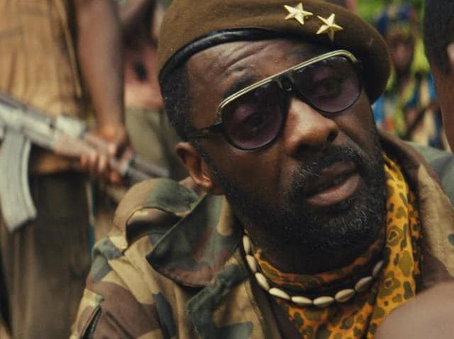Fukunaga's Beasts of No Nation focuses on the harrowing journey of a West African boy, Agu, as he is  captured and brainwashed into a child soldier by Idris Elba's merciless Commandant.