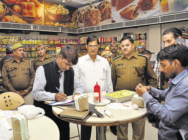 Senior police and district administration officials during an inspection at a prominent sweet shop in Ghaziabad on Wednesday.