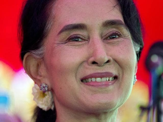 Myanmar's opposition leader Aung San Suu Kyi addresses the media at a press conference at her home in Yangon, Myanmar, Thursday, Nov. 5, 2015. On Sunday Myanmar will hold what is being viewed as the country's best chance for a free and credible election in a quarter of a century.