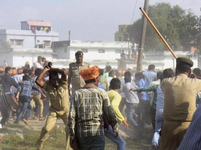Police lathicharge BJP supporters after they wen out of control at Prime Minister Narendra Modi's election rally in Darbhanga on Monday. PTI