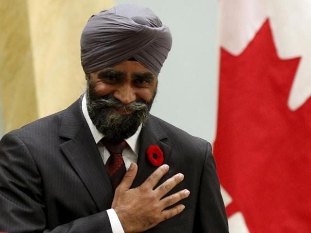 Defense minister Harjit Singh Sajjan reacts after being sworn in during a ceremony at Rideau Hall, in Ottawa.