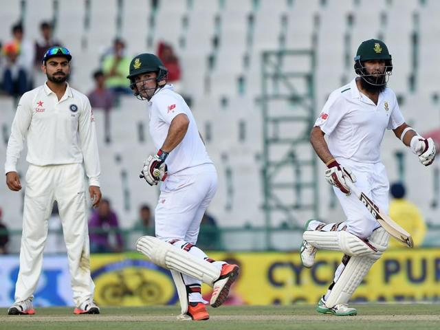 South Africa's Dean Elgar, third from right, celebrates the dismissal of India's Wriddhiman Saha, left, with teammates on the first day of the first Test in Mohali on November 5, 2015.