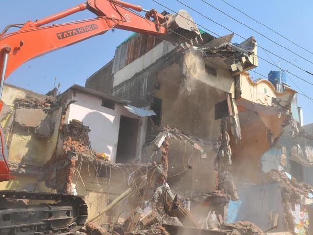 IMC conducted a massive demolition drive for the second day on Kanadia Road in Indore on Thursday.