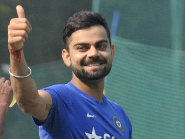 Indian Test skipper Virat Kohli waves towards fans during practice before the start of India's first Test against South Africa in Mohali on November 5, 2015.