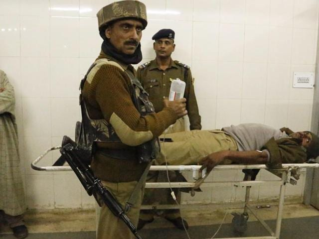Indian paramilitary soldiers attend to their wounded colleague inside a hospital in Srinagar.