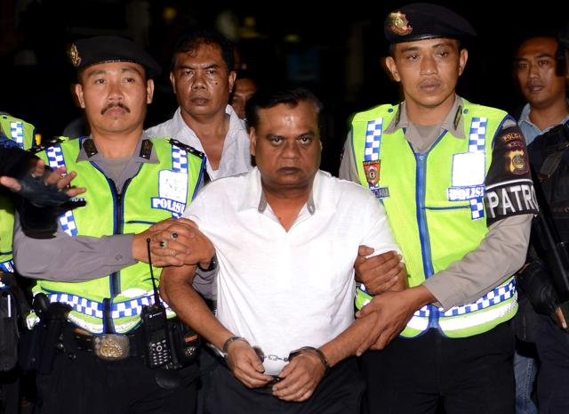 Police escort Indian gangster Rajendra Nikalje, widely known as Chhota Rajan, at police headquarters in Denpasar, Bali November 2, 2015 . Rajan has been deported to India to face charges in more than two dozen murder cases at home.