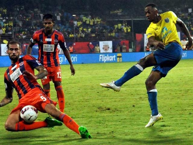Kerala Blasters FC ( Yellow) and FC Pune City players in action during the ISL match in Kochi on November 4, 2015.