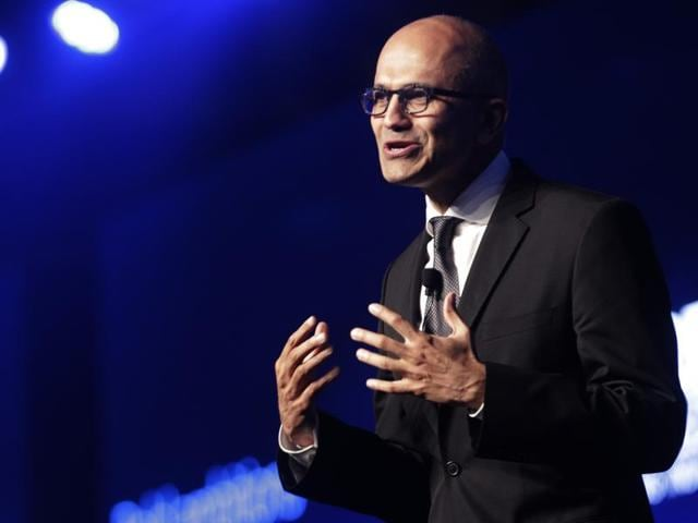 Technology giant Microsoft's Indian-origin chief executive Satya Nadella interacts during the announcement of the company's new partnership with India's e-commerce leaders in Mumbai.