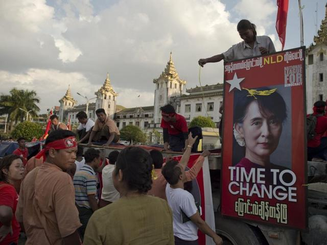 Supporters of Myanmar opposition leader Aung San Suu Kyi's National League for Democracy (NLD) hold up their hands during a NLD rally in Yangon on November 5, 2015. The once junta-run nation heads to the polls on November 8 in what voters and observers hope will be the freest election in decades.