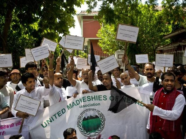 Nepalese men, mostly from Madhesi community, protest against the new Constitution outside the Nepalese embassy in New Delhi, India.  In an unprecedented move, India has slammed Nepal for human rights violations at the UN.