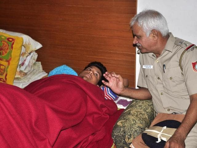 A cop talking to Gaurav at the latter's house in Panchkula on Wednesday.