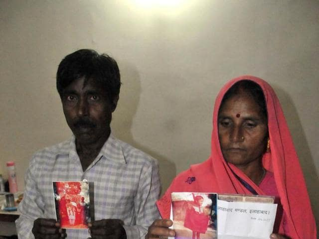 Rajaram Gautam and Annar Bai show photos and documents to prove they are Geeta's parents, in Indore on Wednesday.