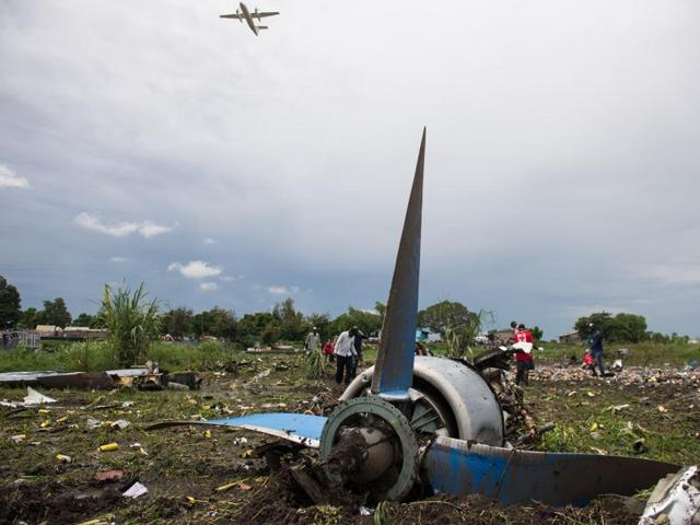 Officials and Red Cross workers remove a dead body of a passenger from the scene of a cargo airplane that crashed after take-off near Juba Airport in South Sudan . The head of the country's Civil Aviation Authority has said that the plane was not authorised to carry people.