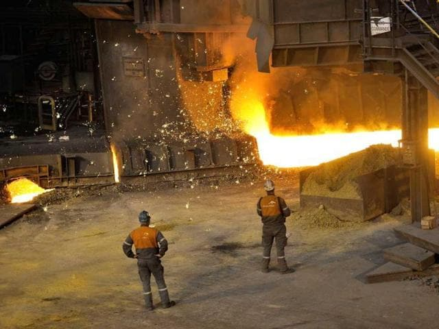 Employees at the ArcelorMittal steel plant of Grande-Synthe, northern France.  ArcelorMittal Europe has reported an operating loss of 23 million euros for the third quarter ended on September 30.