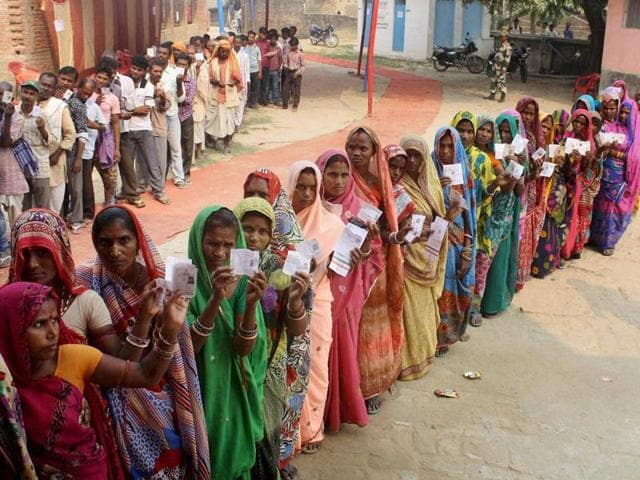 Voters wait in queues to cast their votes during fifth phase of Bihar elections in Darbhanga.