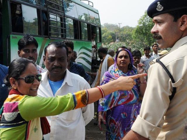 Damoh zila panchayat vice-president Rambai confronts a policeman during a demonstration at TT Nagar in Bhopal.