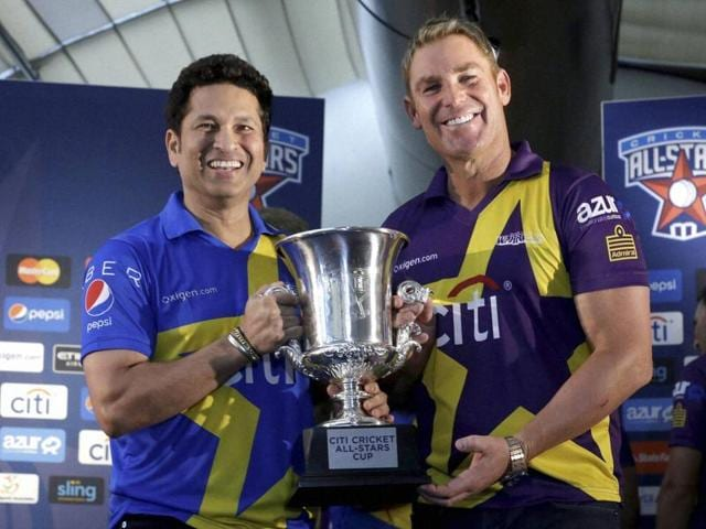 Sachin Tendulkar, left and Shane Warne pose for photographers with the Cricket All Stars Cup during a news conference ahead of the Cricket All Stars three-game series to be played in Major League Baseball stadiums in New York, Houston and Los Angeles, Thursday.